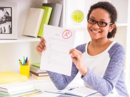 Teen girl holding a school paper