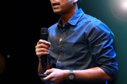 man presenting at talk